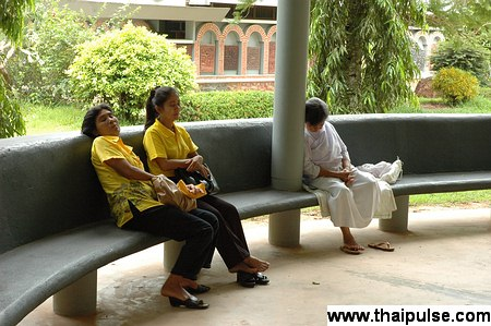 Women sleeping at Dhamma talk in Thailand