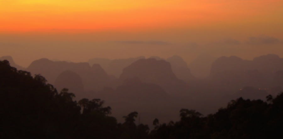 View at sunset from the top of a 280 meter hill at a Buddhist temple in Krabi..
