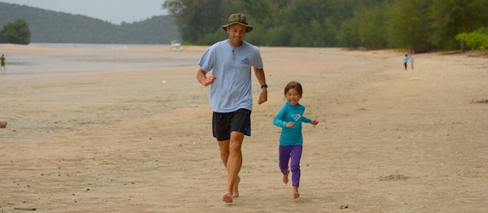 Vern and daughter running on the beach in Thailand.