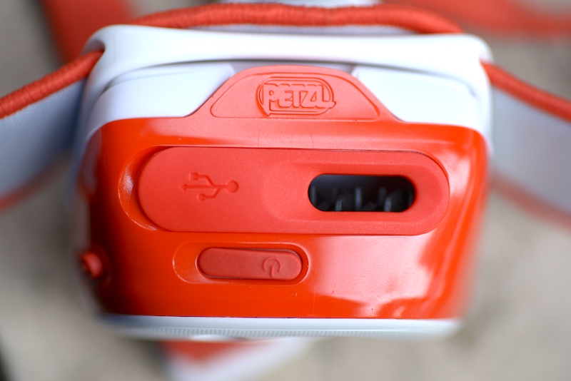 PETZL TIKKA RXP Headlamp power switch, heat sink, and USB charging port.