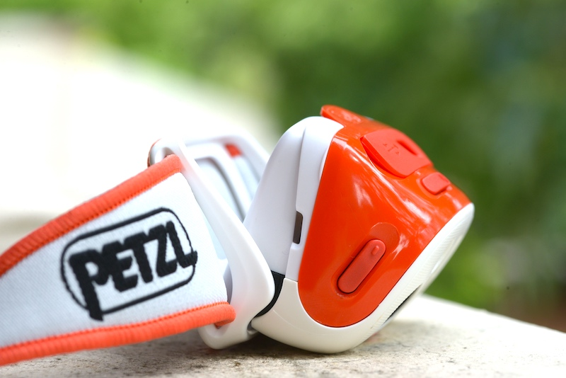 PETZL TIKKA RXP Headlamp side adjustment range shown.